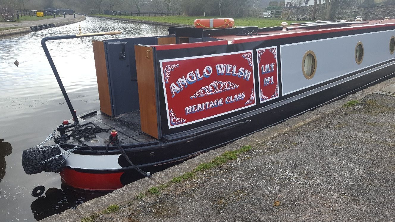 Lily's traditional narrowboat livery.
