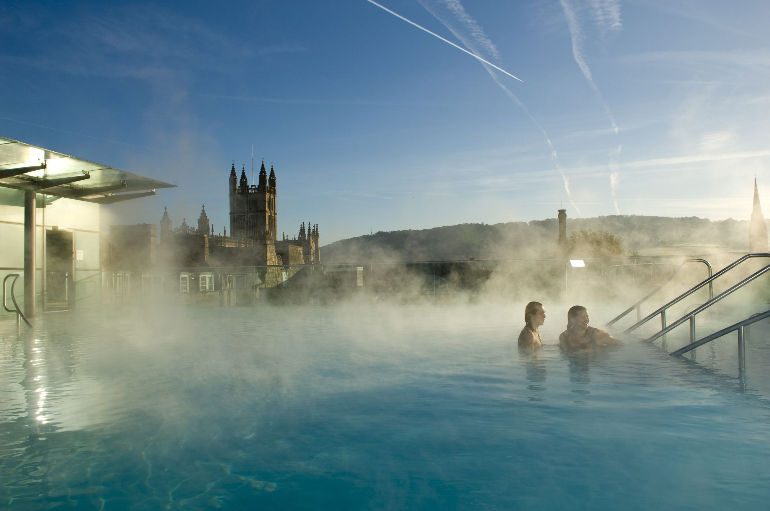 Warm yourself in natural hot spring water during a winter visit to Bath.