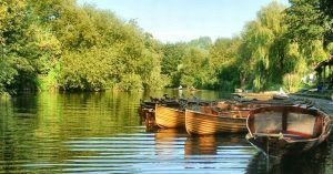 Enjoy rowing or punting on the River Avon during a minibreak in Bath